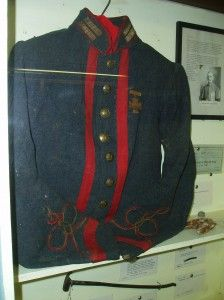 "This late war jacket with Script ""I"" buttons was worn by Confederate artillery officer William Blakemore. The red trim was added post-war."