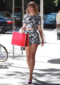 Legs for days: Taylor Swift showcased her epic physique and long slender legs in a midriff revealing floral outfit during a photo shoot in New York City on Sunday