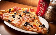 A slice of Pizza and Coke is the best combo after a tiring work day. Don't you think? #mumbai #pune #homedelivery #pizza #coke