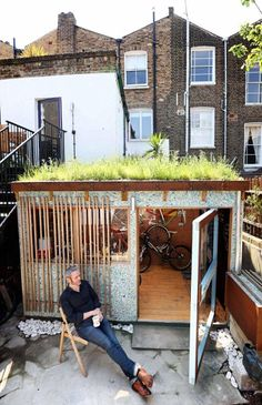 Eco bike høøse owned by Camden Town resident Marcus Sheilds has won Best Eco Shed for his brightly coloured, sustainable eco-shed, complete with a wildflower 'green roof' and recycled yogurt carton cladding which houses his and his wife's 11 bikes.
