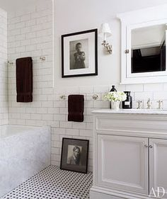 Bathroom.  Large subway tile, basket weave, Carrera Marble.