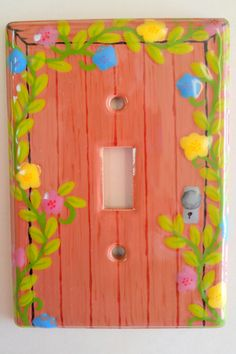 Light switch plate painted to look like a door.