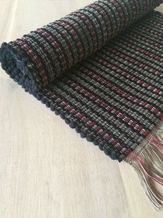 """Traditionally """"rag rugs"""" were made from garments and cloth that are no longer in use. The unused fabric was torn into strips, sewn together, and loomed into floor rugs. The Pendel Rugs are hand loomed"""