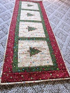 Looking for quilting project inspiration? Check out Christmas table runner by member fabriccreations. - via @Craftsy