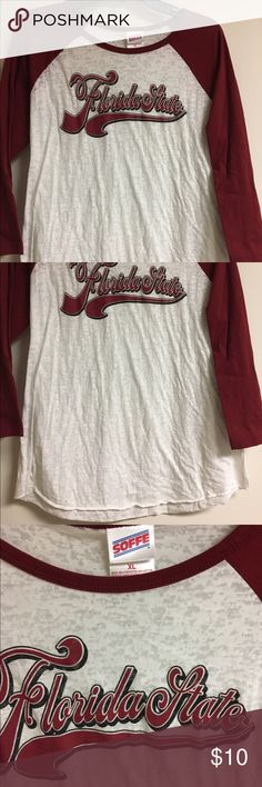 Soffe XL Florida State Seminoles 3/4 Sleeve Shirt Soffe XL Florida State Seminoles shirt with 3/4 sleeves. Excellent condition, washed but never worn. No holes, no stains, no flaws of any kind. Check my other items for bundles! I'll be listing about 200 items in the next week or so. I have entirely too many clothes and I'm running out of closet space! Time to consolidate and find new homes for all these pieces. All items come from a smoke free home. Offering a 10% bundle discount on 3+ items…