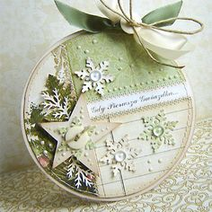 handmade Christmas Card ... circle shape ... die cut star and snowflakes ... Liquid Pearl dots and dew drops ... soft Vintage look in green and linen ... lovely ..