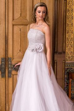 Freya- Beautiful silver gown with French corded lace bodice and keyhole back detail.  Full tulle skirt with detachable floral trims