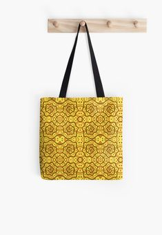 Helices, yellow & brown abstract pattern Tote Bags by Clipsocallipso Worldwide shipping  Brown helices and dots on shining yellow background. Seamless abstract hand drawn arabesque pattern.   © Clipso-Callipso / Julia Khoroshikh  #yellow #brown #yellowandbrown #helices #arabesque #pattern #abstract #curves #patterndesign #clipsocallipso #printshop #textiledesign #apparel  #yellowaesthetic #redbubble  #tote #totebag #totesshoppers