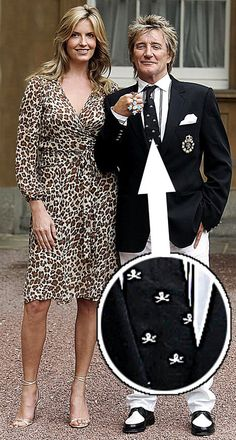 Rod Stewart & Penny Lancaster - receiving his CBE four weeks after marrying Penny. Wearing jeans and skull and crossbones tie! He received the honour from Prince Of Wales for five decades of service to the music industry.