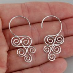 """Description Cascading swirl hook earrings are made of .925 genuine sterling silver. Perfect for sensitive ears. Dimensions: 35mm (1 6/16"""") long Cascading swirl earrings come in a gift box.  #SilverJewelry"""