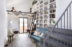 Designed by Egue Y Seta, this inspiring apartment is located in Madrid, Spain. The designers turned an old Madrid house from the into a new and welcoming home to a young couple with kids. They reconstructed the unique place, with pieces of custo Home Library Design, House Design, Library Ideas, Library Ladder, Bookshelf Ladder, Library Chair, Small Home Libraries, Madrid Apartment, Deco Design