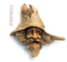 """Flabbergasted""   This nautical knot head measures 5½ inches  tall and 5¾ inches across his widest point.  A natural barnacle has stowed away on  the brim of this driftwood spirit's hat.        Signed and dated:  N. Tuttle 11/19/13  ~"