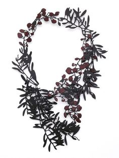 Necklace | Helen Shirk. Mild steel, patina, china pain