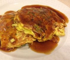 Egg Foo Yong is simply an omelet, if you have eggs and leftovers you have all the ingredients you will need.  The sauce also has common ingredients. Author Candy Dorsey provides this delicious recipe.