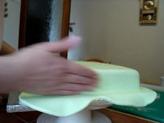How to cover a square cake with sugarpaste/fondant by Lorraine McKay. This is how I cover a square cake with sugarpaste/fondant.  Use this as a guide to help get the smooth finish you see on all of my work. :o)