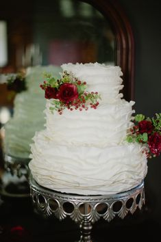 white ruffled wedding cake, a little dressed up