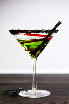 FRANKENTINI This Halloween cocktail is so much fun it could bring Frankenstein to life! Serve this melon martini at your Halloween Party and you & your friends will be getting your ghoul on in no time! Don't forget the spooky black sugar rimmed glass & licorice garnish for full freak out!