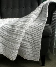 Where the Sidewalk Ends blanket knitting pattern by Fifty Four Ten Studio. Knit with super bulky yarn. Easy to knit chunky blanket pattern. Instructions for five sizes included.