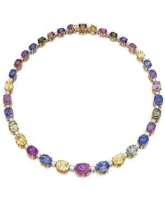 18 KARAT TWO-COLOR GOLD, MULTI-COLORED SAPPHIRE AND DIAMOND NECKLACE, BULGARI. Set with 33 oval and cushion-cut sapphires of various hues weighing 96.41 carats, spaced by 34 round diamonds weighing 4.06 carats, length 16 inches, signed Bulgari. With signed case.
