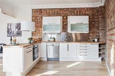 White kitchen, brick wall