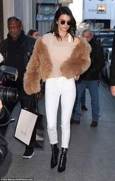Kendall Jenner wearing Linda Farrow Lfl 479 Sunglasses, Mother Looker Ankle Fray Jeans in Pretty Just Strolled Into the City Warm Ivory, Versace Layered Effect Boots and Nili Lotan Gabrielle Sweater