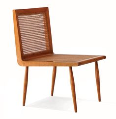 Joaquin Tenreiro's low bedroom chair in caviuna wood with a woven cane seat and back, circa 1950