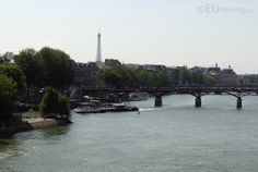 Here in this photo you can see the very tip and end of the Ile de La Cite island with a tour boat going past and beneath a bridge on the River Seine.  Want to learn more? Go to www.eutouring.com