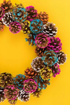 Learn how to make a colorful pine cone fall wreath that is perfect for both Thanksgiving and Christmas. Learn how to make a colorful pine cone fall wreath that is perfect for both Thanksgiving and Christmas. Diy Fall Wreath, Fall Diy, Holiday Wreaths, Wreath Ideas, Fall Crafts, Christmas Crafts, Diy Crafts, Christmas Colors, Christmas Christmas