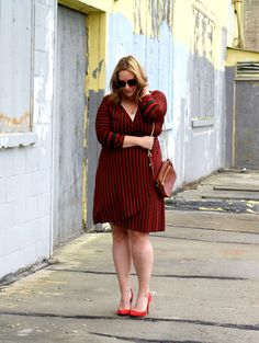 In Kinsey's Closet| Thrifted wrap dress.  It only cost 6 bucks!