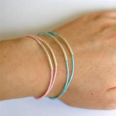 Make a pretty bracelet with noodle/curve beads and waxed cotton cord.