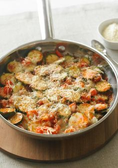 Skillet Parmesan Zucchini — Zucchini and other garden veggies are skillet cooked until crisp-tender before being topped with mozzarella and Parmesan. So easy and so good.