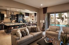 Lovely open concept done in warm neutrals.  #openconcept #roomdesigns homechanneltv.com