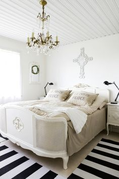 The detail in the bed frame is gorgeous..not to mention I dig the white and linen bedding