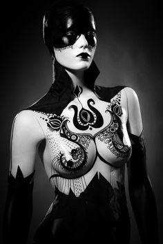 █▄◯╲╱ Ξ   body painting    unknown