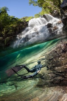 Freediving under the paradise water fall Photo by Marc Henauer -- National Geographic Your Shot