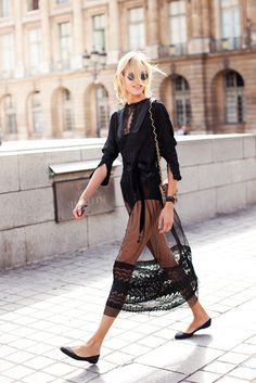 Anja Rubik confidently flashes her pins beneath a sheer chiffon and lace skirt, then subtly tempers the sensuality with flat pumps | Styloko.com