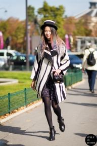 Irene Kim, Korean model, wearing LOUDMUT coat, suecommabonnie boots and Chanel bag before Carven fashion show. Shop this look (or similar) here: Coat: Religion Striped Wool Cocoon Coat Boots: Pull & Bear Double Buckle Suede Western Ankle Boots Bag: SAINT LAURENT Monogramme Sac Université small