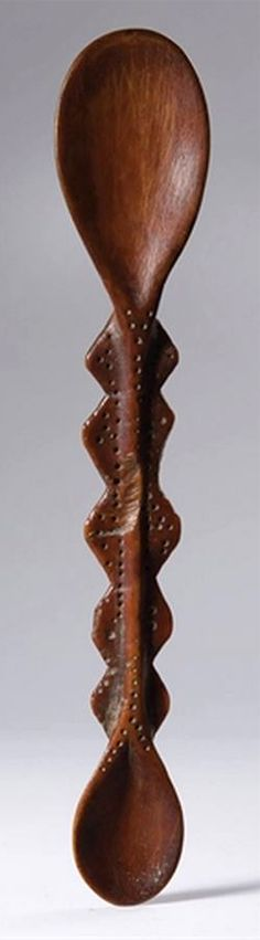 Africa | Spoon from the Lega people of DR Congo | Ivory; brown patina | ca. 1950s