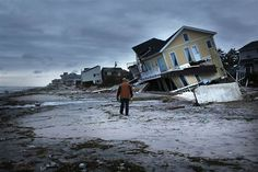 Damage is viewed in the Rockaway neighborhood where the historic boardwalk was washed away during Hurricane Sandy on October 2012 in the Queens borough of New York City. (Photo by Spencer Platt/Getty Images) Hurricane Damage, Hurricane Sandy, Hurricane Preparedness, Disaster Preparedness, Natural Disasters, Global Warming, East Coast, Climate Change, Couple