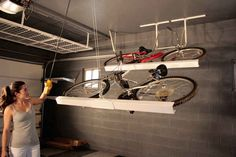 Store bikes horizontally along the ceiling.