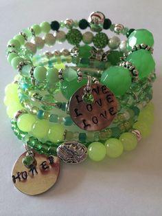 August birthstone (peridot) memory wire bracelet. Friend me on Instagram @daneec58 #denisebellinger to see only my handmade jewelry #stampedjewelry #wirewrap #peridot #love #green #handmadejewelry