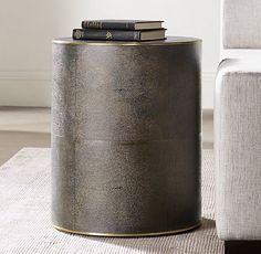RH Modern's Shagreen Cylinder Round Side Table:A 1970s interpretation of French Art Deco design, our table from designer Anthony Cox celebrates the marriage of two eras. With elegant materials and a refined form, it's clad in rich shagreen-embossed leather with metal trim detail.
