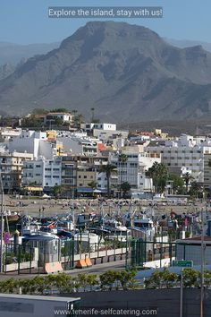 View of Los Cristianos beach with flat mountain in the background. Tenerife Beaches