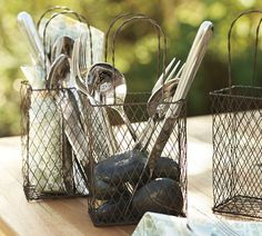 "Love these mini ""shopping bag"" wire baskets from Pottery barn!  Could use them for SO many things!"