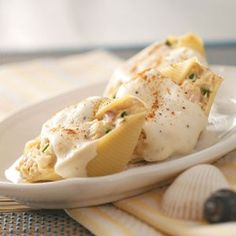 Seafood stuffed shells- lobster, shrimp, ricotta, parm. and some seasoning for the stuffing is all that you need. top with a lite Alfredo sauce thinned with white wine. yummy!