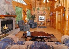 The cozy living room with a fireplace at a Pigeon Forge cabin.