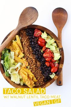 An easy and healthy Vegan Taco Salad. Made with a lentil/walnut taco meat, black beans, cherry tomatoes, and avocado and dressed with a creamy avocado salsa for a wholesome, plant-based, gluten free meal. #vegan #glutenfree #veganrecipes #vegantacos #veganglutenfree