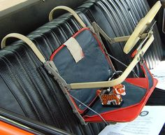 1960s baby car seat. Look at how much the car seat has evolved...this doesn't look safe AT ALL!