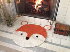 Wouldn't this crochet rug be adorable in a kid's room?