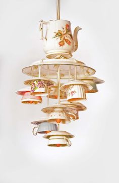 Chandelier made from a vintage teapot, tray, and cups.